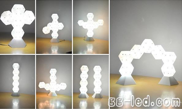 Dodecado台灯采用模块化设计,每个模块都是一个正十二面体,每个模块都有15种颜色共选择,正十二面体形状的模块内置不同色彩的LED与充电电池,彼此之间依靠磁性相连,可堆叠在供电基座上,也可充满电后单独使用,一次充满电可以连续工作2.5小时。